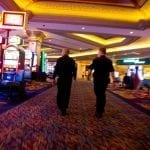 two security guards walking in a casino room