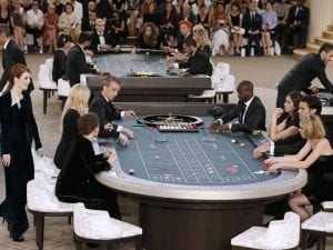 people palying poker in the middle of a runaway show
