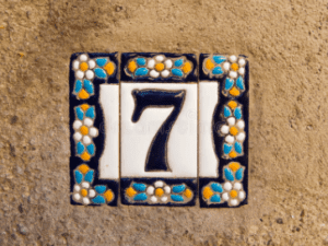 a ceramic 7 with floral arangement in blue and white color