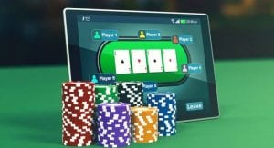 a tablet with poker chips near it