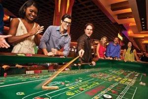 people playing a casino game gambling
